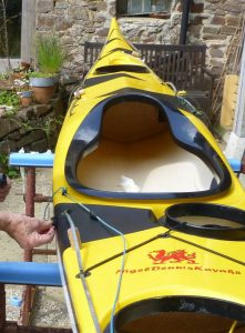 Black triangles on yellow kayak