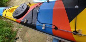 yellow kayak black blue pink