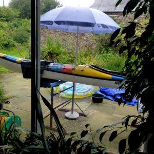 Kayak paint job under the umbrella
