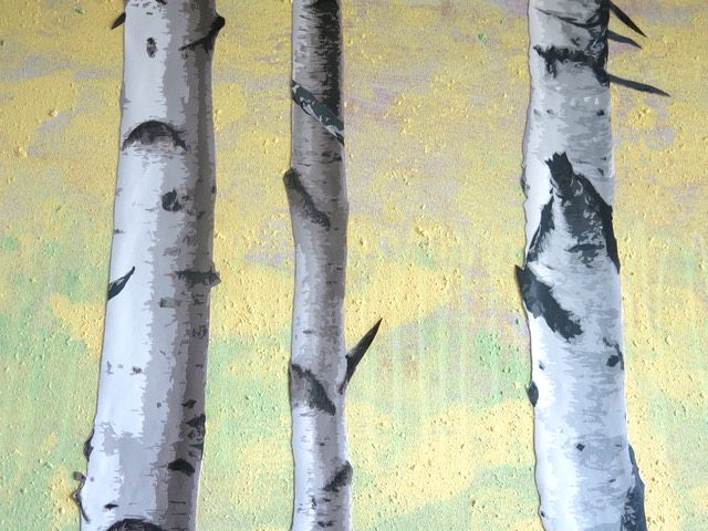 Upcycling kids paint and stick trees